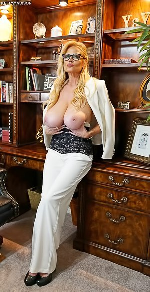 Busty blonde in white pants showing off her saggy tits in the office