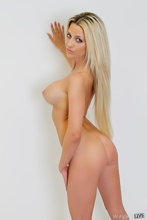 Rainbow socks blond-haired cutie posing with her amazing ass to the cam