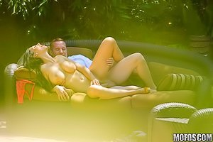 White skirt brunette MILF banging her boy toy on a couch outdoors