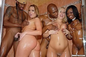 Bathrobe-clad babes enjoying their hardcore interracial orgy