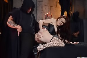 Wavy-haired hottie getting her asshole banged by some hooded cultists
