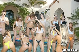 Horny bikini-clad hotties have fun with each other and fuck a hung guy