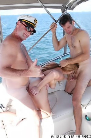 Thick blonde in a white bikini getting banged by two hung dudes
