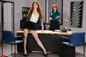 Redhead with a pale body sucking cock and fucking at the office