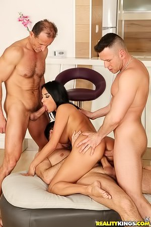White pants oiled-up brunette gets banged by two hung studs at once