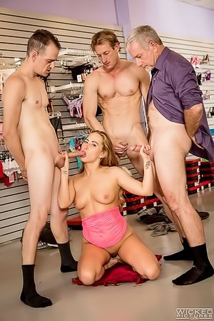 Dress-wearing blonde bombshell gets gang-banged in some store