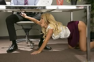 Long-haired blonde in a purple skirt gets fucked on an office table