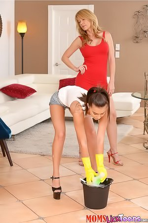 Blond-haired MILF ruthlessly dominating a ponytailed maid teen