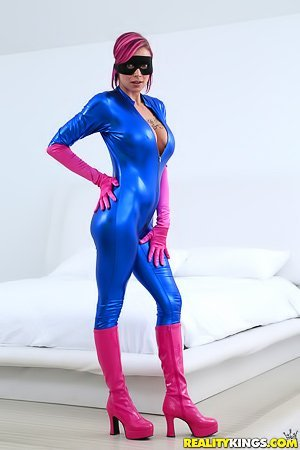 Domino mask spandex-clad superhero slut gets fucked on a bed