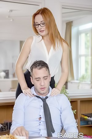 Redheaded MILF slut with glasses blows her tired-looking partner