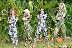 Bodypaint hotties licking each other's pussies in their camo-style paint