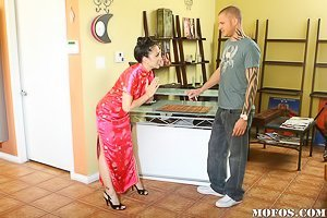 Colorful dress Asian MILF masseuse fucking her younger client
