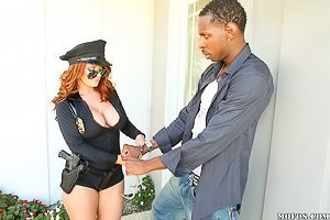 Shades-wearing cop lady redhead gets banged by a black criminal