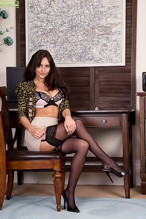 Stockings-clad brunette masturbating and looking fine in the office