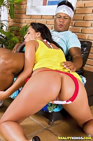 Oily Latina in red panties sucking a massive black cock before riding it
