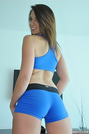 Blue-eyed brunette in a sporty get-up fucking a hung dude on cam