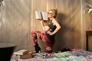 Busty blonde with cute glasses posing in her overly artsy room