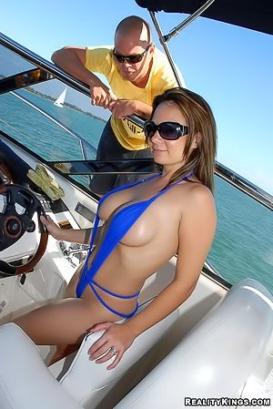 Busty brunette with a round booty gets her ass banged on a boat
