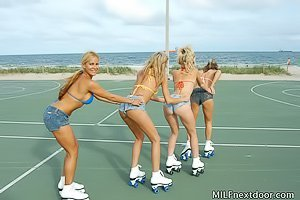 Four sexed-up hotties rollerblading and eating each other's pussies