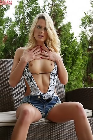 Long-legged blonde in denim shorts ends up undressing and fingering