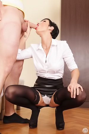 Stockings-clad and short-haired brunette MILF fucking a hung guy