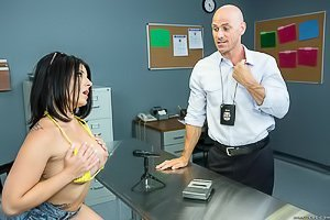 Dark-haired bombshell with tats on her back gets drilled by a cop