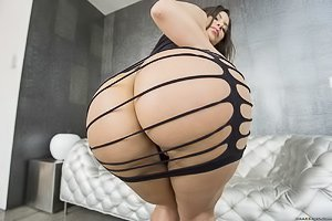 Thick brunette dressed in a black ripped bodysuit gets drilled by a hung du