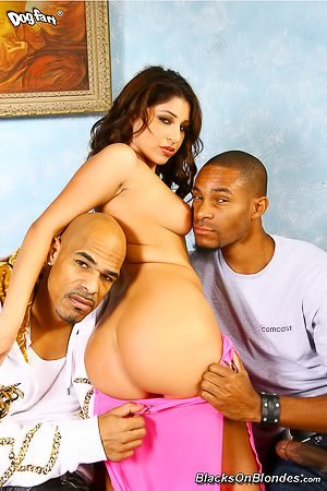 Pink dress brunette bombshell gets fucked by two hung black dudes