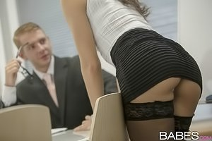 Glasses-wearing brunette in stockings gets licked and dicked by her boss