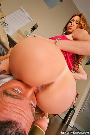 Pink dress redhead with a massive ass gets fucked by a hung dude